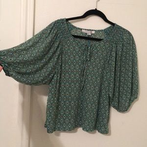 Teal tan and black patterned shirt
